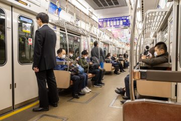 People on a train in Osaka